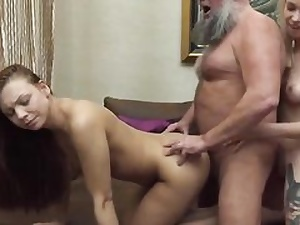 A blonde and a brown-haired in old and youthful three-way hard orgy tape
